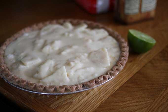 An unbaked pear custard pie on a countertop | Foodal