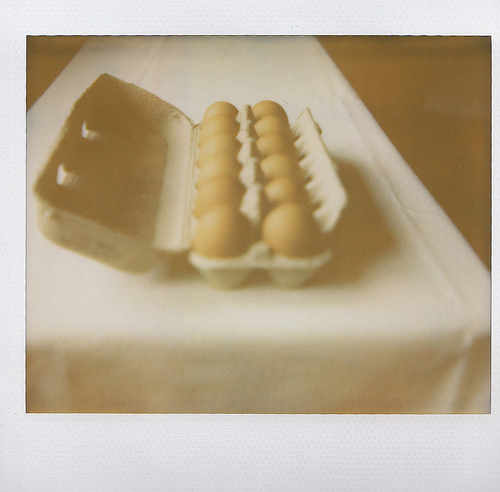 An image of brown eggs in a carton egg tray.