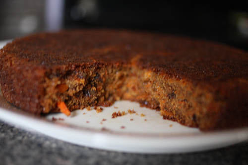 An image of a carrot cake with slivers of carrots showing.