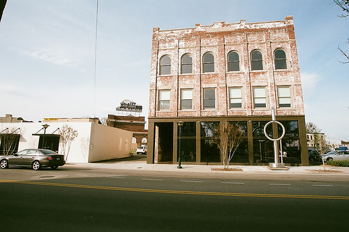 A beautiful image of an old building in contrast with newer smaller building beside it.