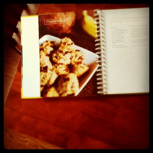 An image of an open recipe book on a table.