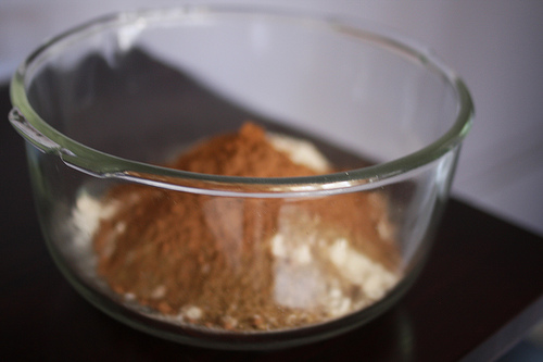 An image of glass mixing bowl with dried ingredients ready for mixing.