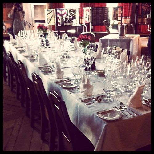 An image of a long table elegantly set for dining.