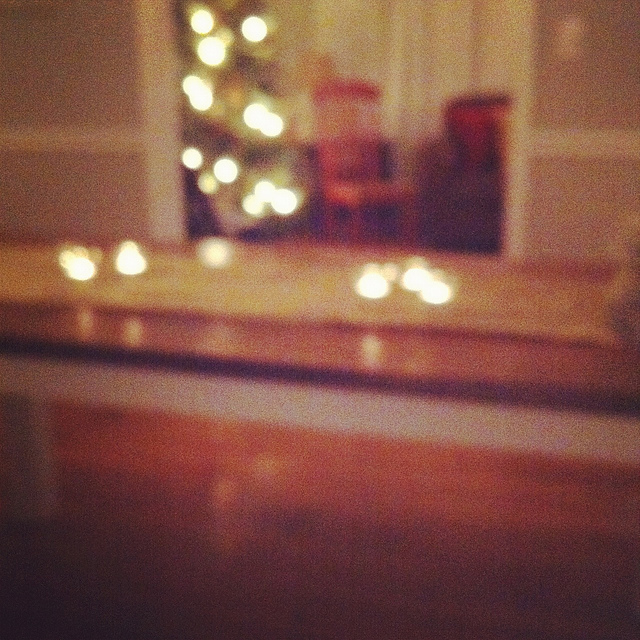 A slightly blurred image of an interior of a house with Christmas lights.