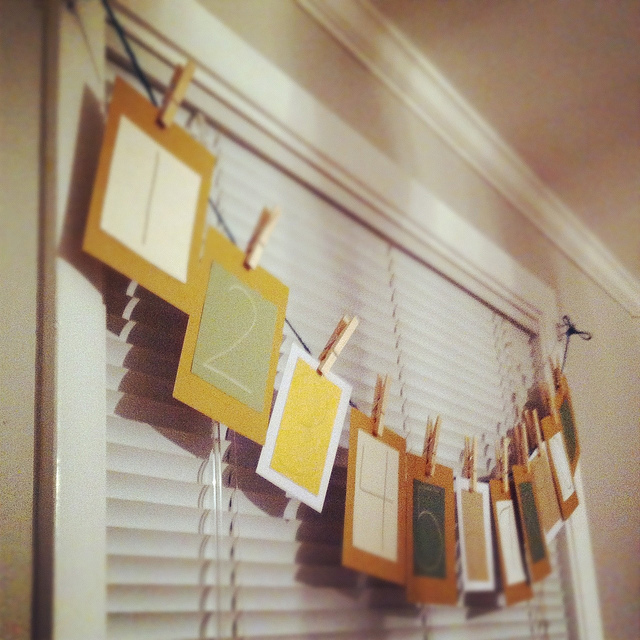 An image of a homemade advent calendar hanging by the window.