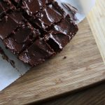 Top view image of yummy brownies on a slab of wood.