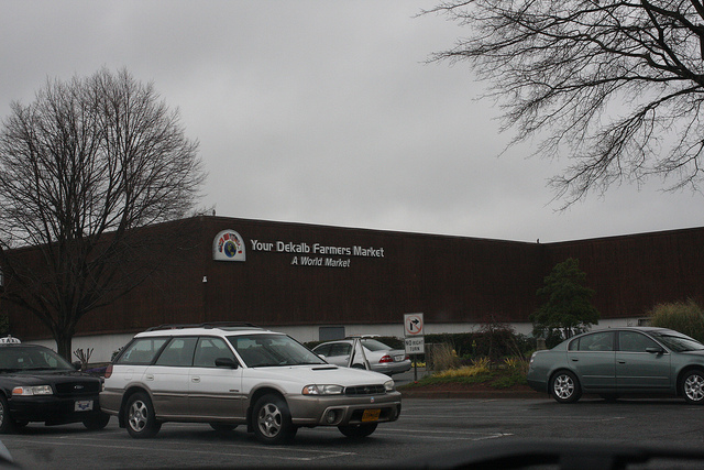 An image of a farmer's market taken from across the road.