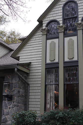 An image of a bed and breakfast inn with beautiful cathedral windows.
