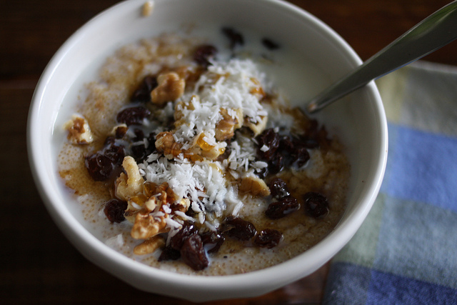 A top view image of a delicious breakfast porridge topped with various goodies.