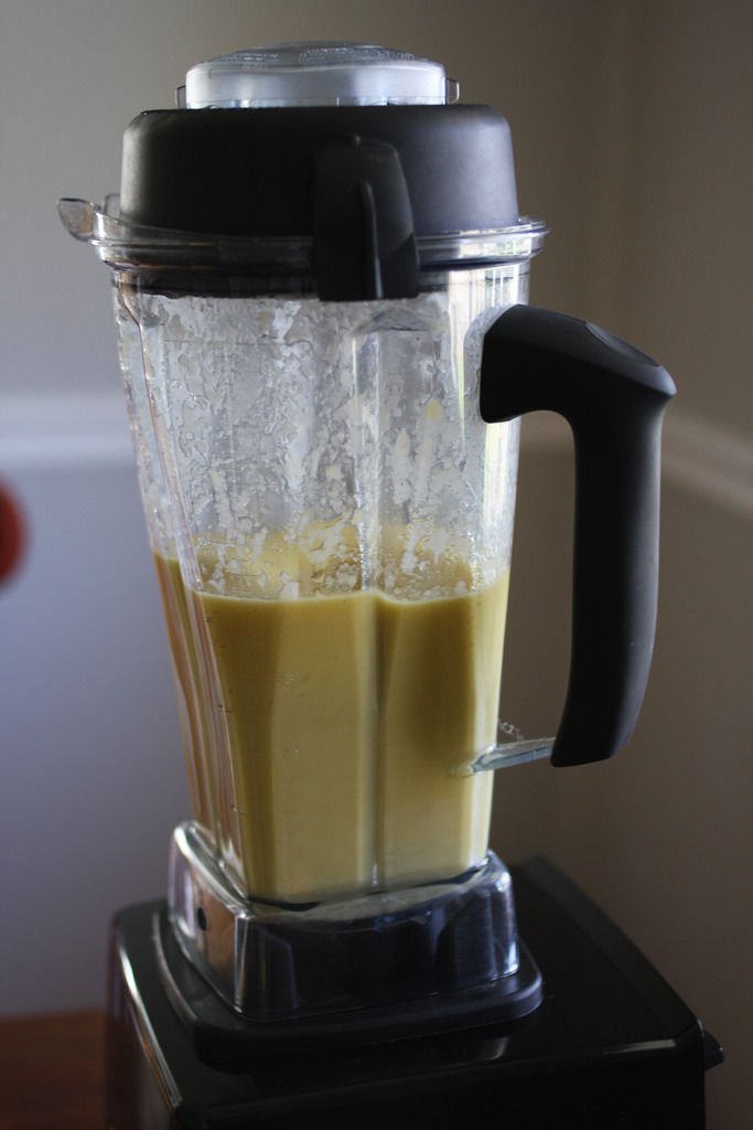 An image of a blender filled citrus mix.