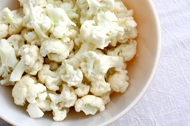 A top view image of a bowl of fresh cauliflower.