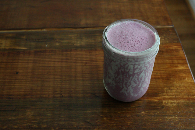 A top view image of a jar filled with blueberry kefir.