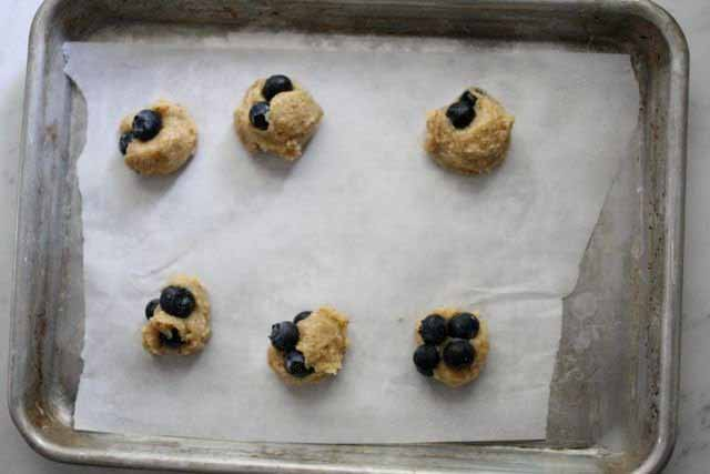Blueberry Cookie Dough Truffles on a baking tray.