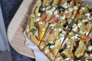 Peach, Spinach, and Goat Cheese Pizza with Kefir-Spelt Crust