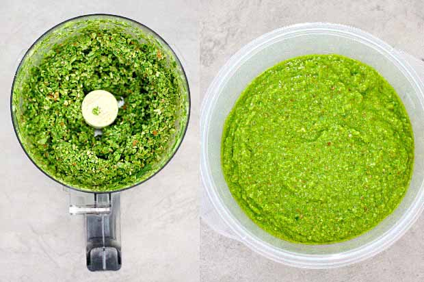 Top down view of garlic scape pesto in a food processor.