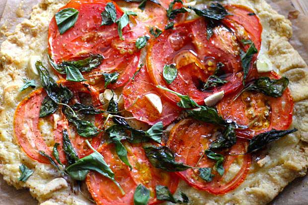 Top down and close up view of a Tomato and Basil Pizza Pastry made with einkorn flour.