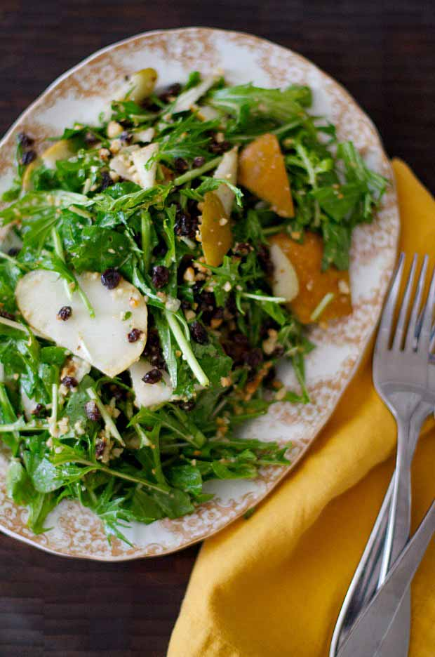 Top down and close up view of a Bosc Pear, Currant, and Hazelnut Salad