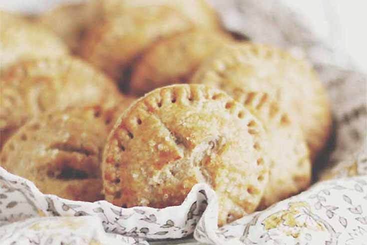 A batch of Sprouted Spelt Root Vegetable Handpies in a basket.