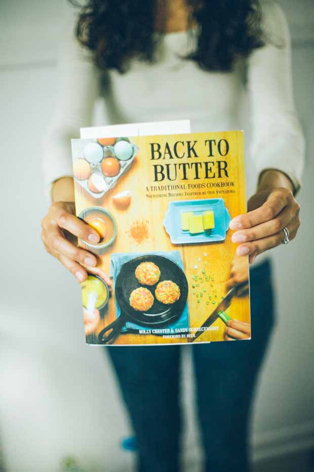 Shanna Mallon holding the Back to Butter cookbook.
