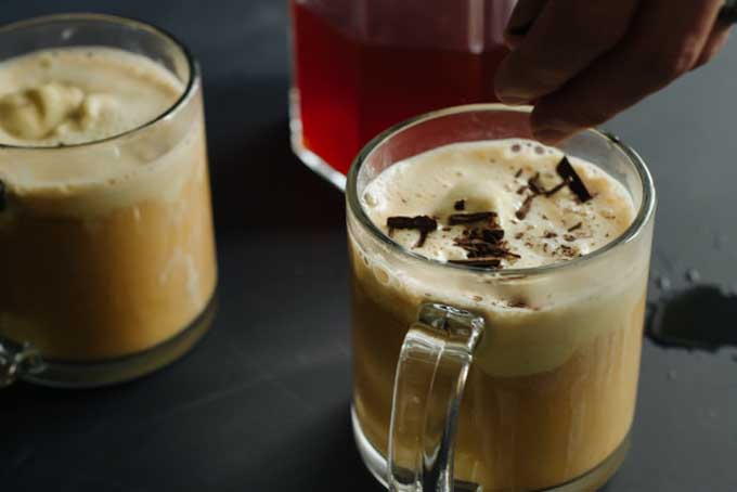 Two mugs of affogato made with honeybush flavored ice cream and rooibos tea | Foodal