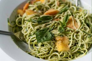 Zucchini Spaghetti with Peaches and Pumpkin Seed Pesto