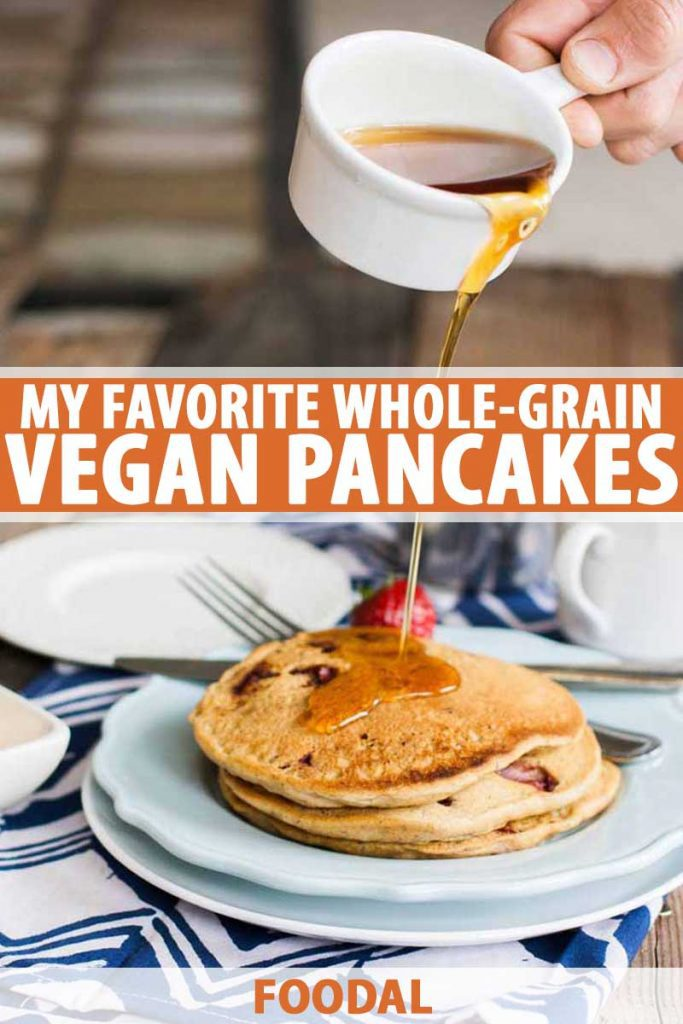 A human hand pours syrup over a stack of homemade vegan pancakes.