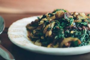 Sautéed Swiss Chard with Caramelized Onions, Almonds and Raisins