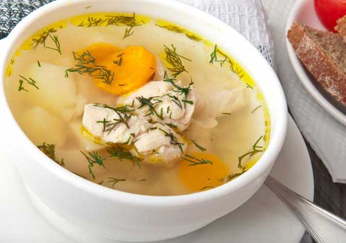 Chicken Soup With Dill in a White Bowl.