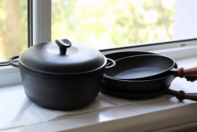Cast Iron Dutch Oven and Frying Pans next to a kitchen window
