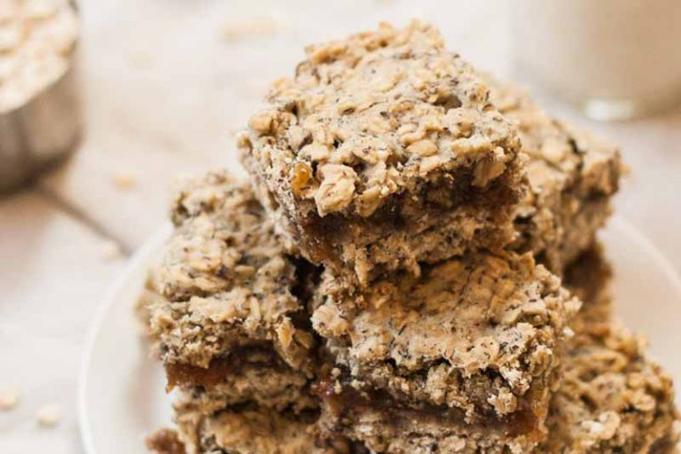A close up of a stack of nutritious gluten-free and vegan breakfast bars that are made with whole ingredients and are similar to fig newtons.