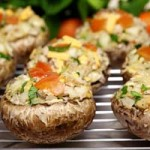 Stuffed mushrooms with tomatoe and parlesly garnishments