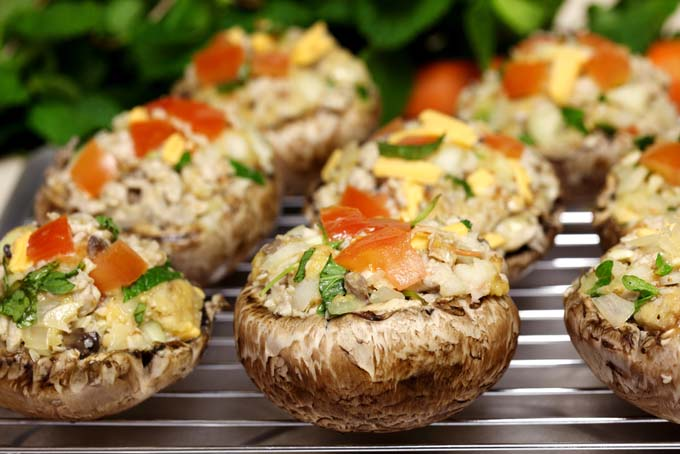 Stuffed Mushrooms with tomatoe and parsely garnishment