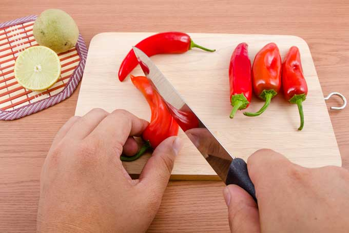 Slicing chilies to dehydrate   Foodal.com
