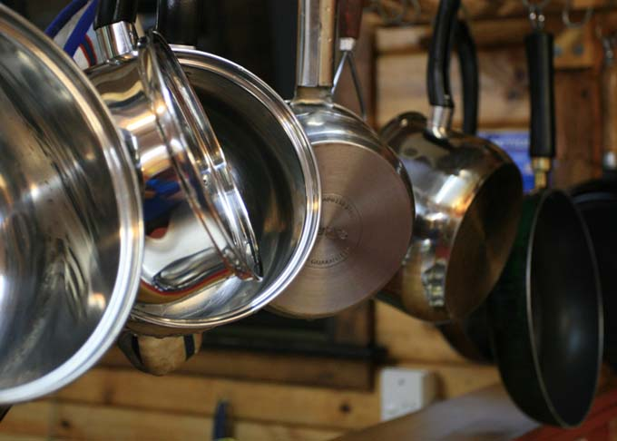 Various types of cookware hanging from ceiling