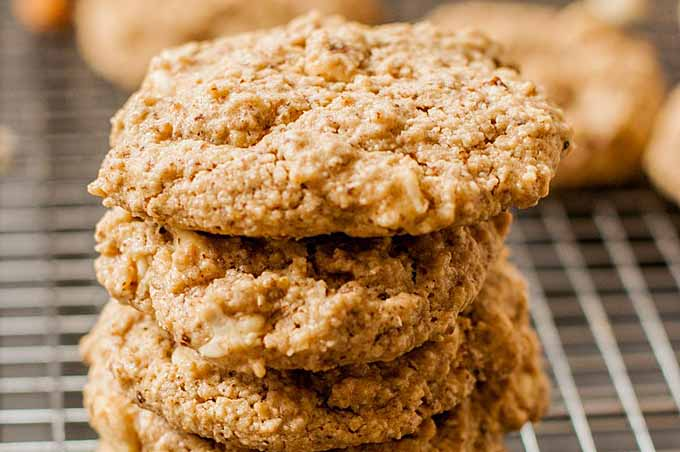 A close up of stack of white chocolate almond cookies.