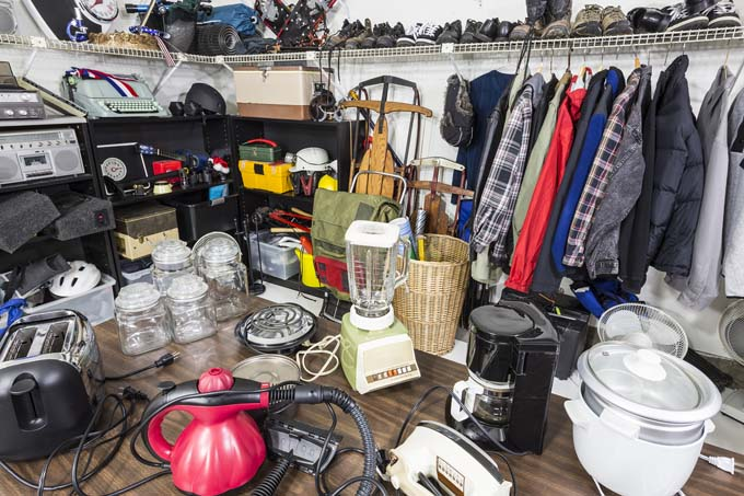 Rummage sale inside of garage = get rid of clutter