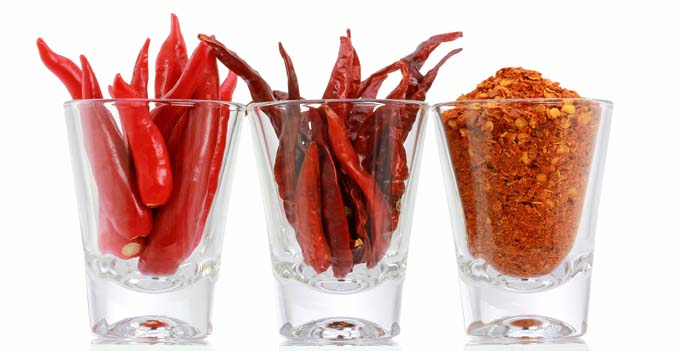 Three versions of Red Pepper : Fresh Chili, Dried Chili and Chili Powder in a glass, isolated on white background