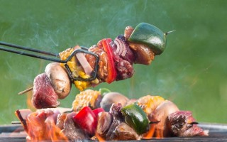 Meat and vegetable kabobs on the grill