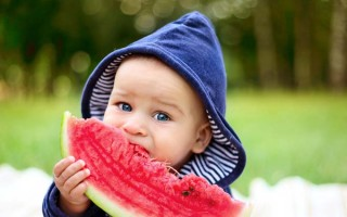 baby eating water melon
