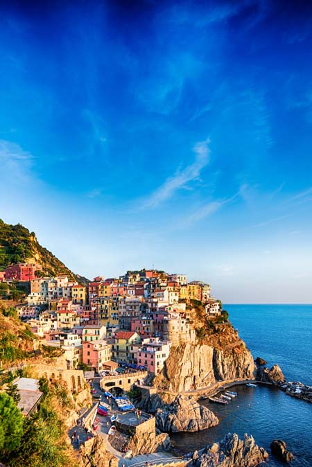 The bluffs and colorful houses of Cinque Terre , Italy also known for great pesto | Foodal.com
