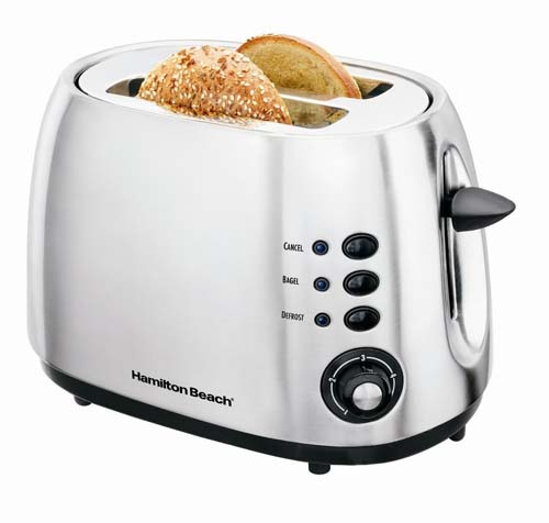 Hamilton Beach 2 slice metal toaster with toast in the slots on white isolated background