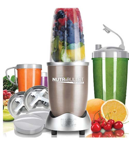 Magic Bullet NutriBullet Pro 900 Series Blender-Mixer System with fruit and components side by side and in foreground - on white isolated background