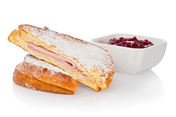 Monte Cristo sandwiche with rasberry jam in white rectangular cup- horizantal view with isolated background