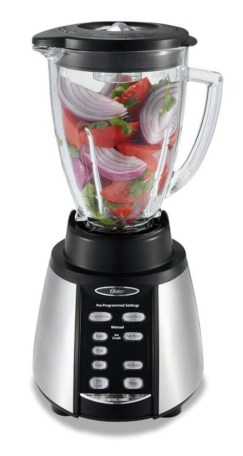 Oster Counterforms 6-cup Glass Jar Blender with chopped up vegetables in the carafe