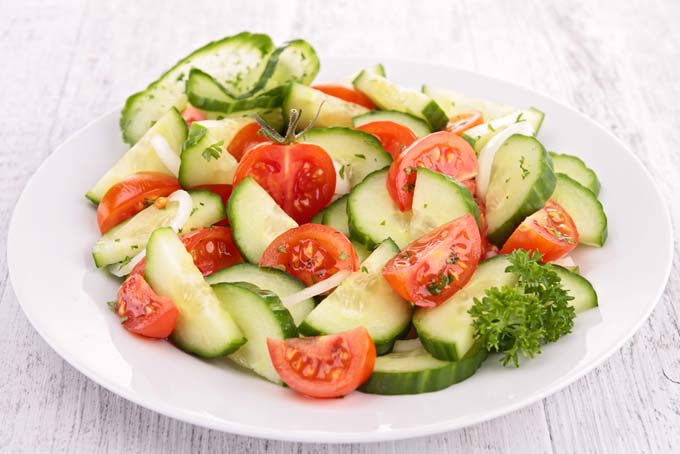 Cucumber onion and tomato salad with vinegar and a small amount of olive oil