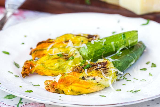 sauteed zucchini blossom stuffed with cheese on plate