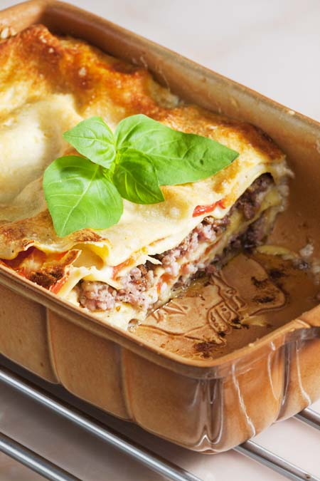 lasagne with ground turkey meat in golden colored backing pan