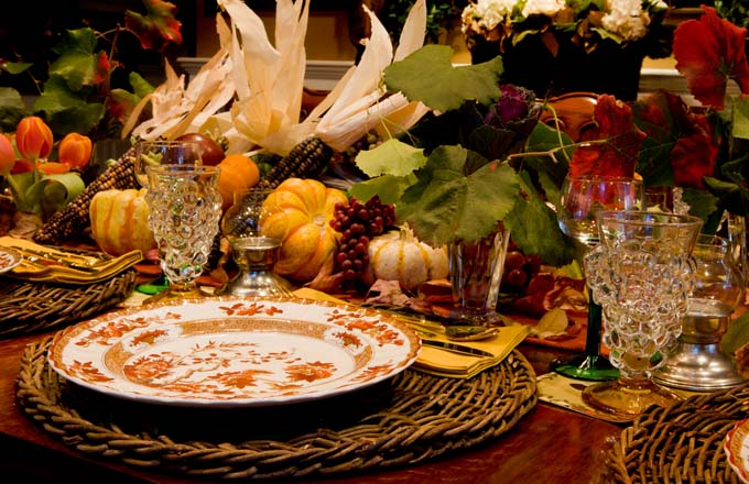 "Formal dining table decroated with the ""good"" china, indian corn, gourd, and grape vines"