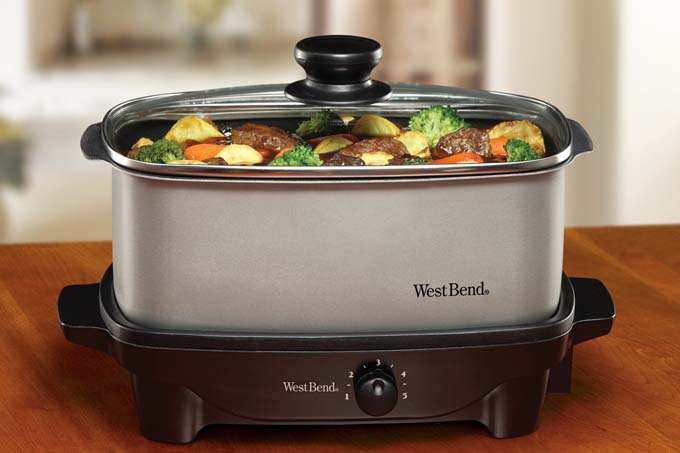 west bend 5 quart slow cooker on wooden table