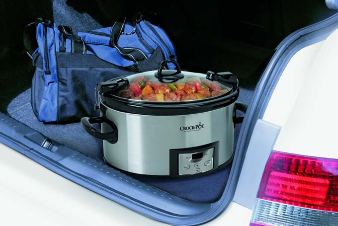 Crock-Pot SCCPVL610-S Programmable Cook and Carry Oval Slow Cooker being transported in trunk of a car demonstrating how easy it is to take this appliance with you to events.